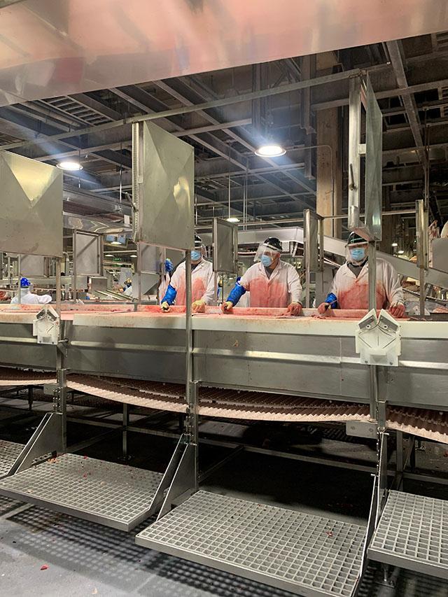 President Domingo Garcia inspecting JBS USA Food Company pla