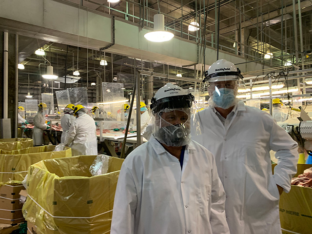 President Domingo Garcia tour with CEO Kenneth Sullivan at Smithfield Foods discussing worker safety.